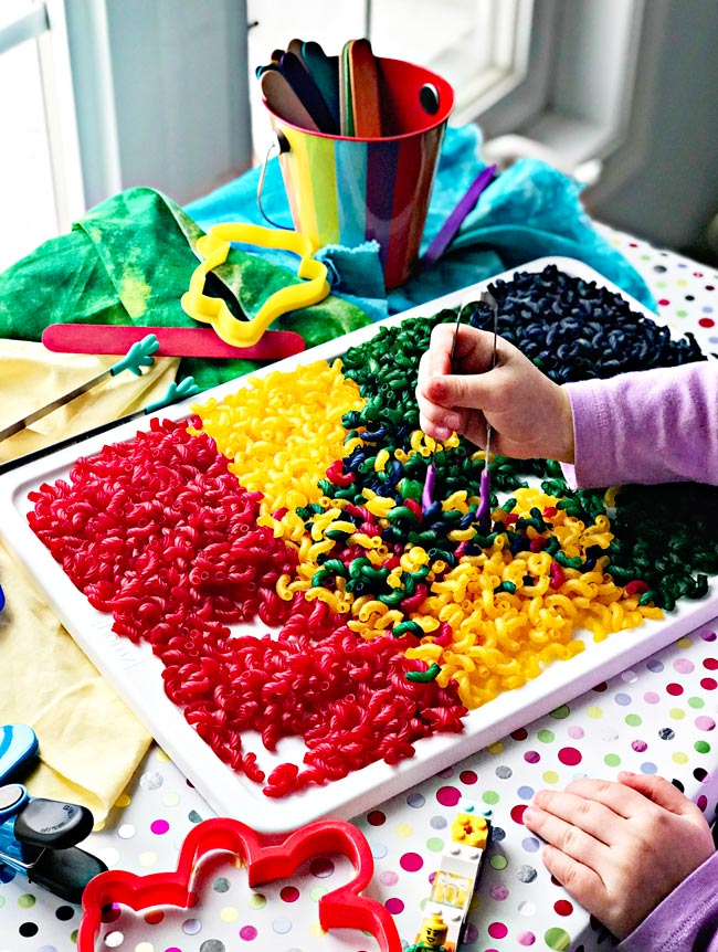 How to dye pasta for sensory play activities using tweezers and other sensory toys and games! | spiritedandthensome.com