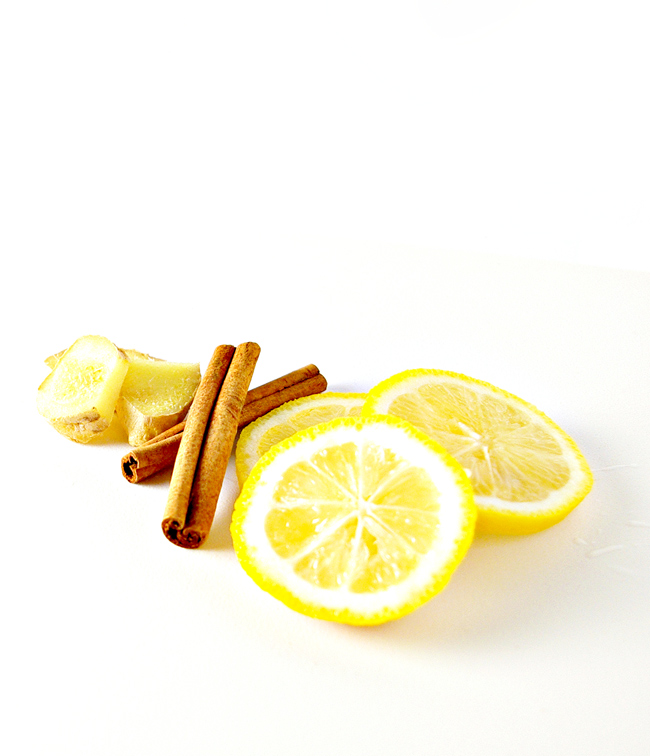 Fresh lemon, fresh ginger, and cinnamon sticks on a cutting board for Lemon Ginger Tea! | spiritedandthensome.com