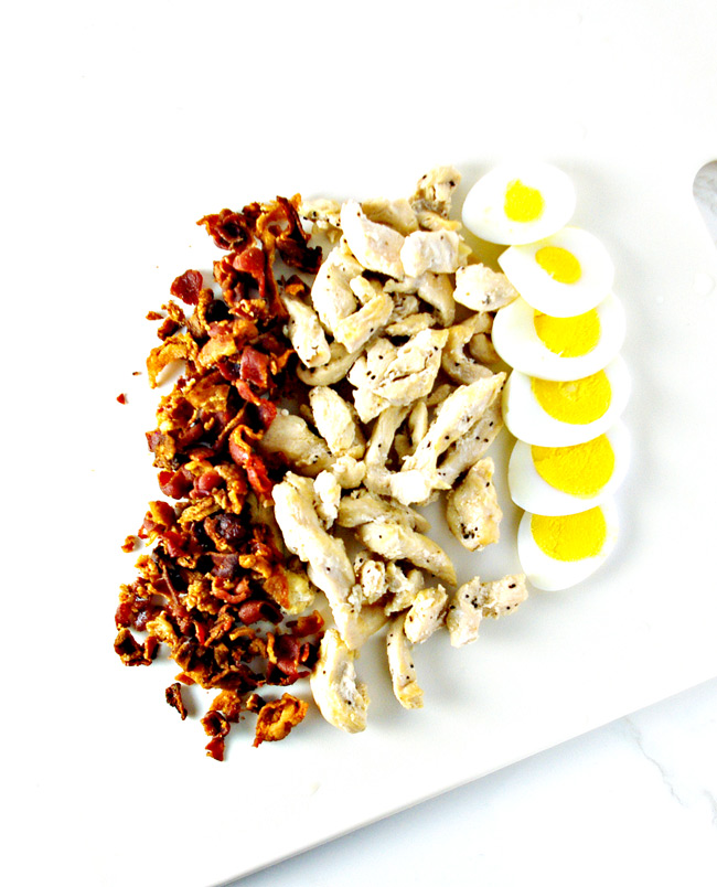 Protein ingredients for Paleo Cobb Salad include bacon, chicken, and eggs! | spiritedandthensome.com