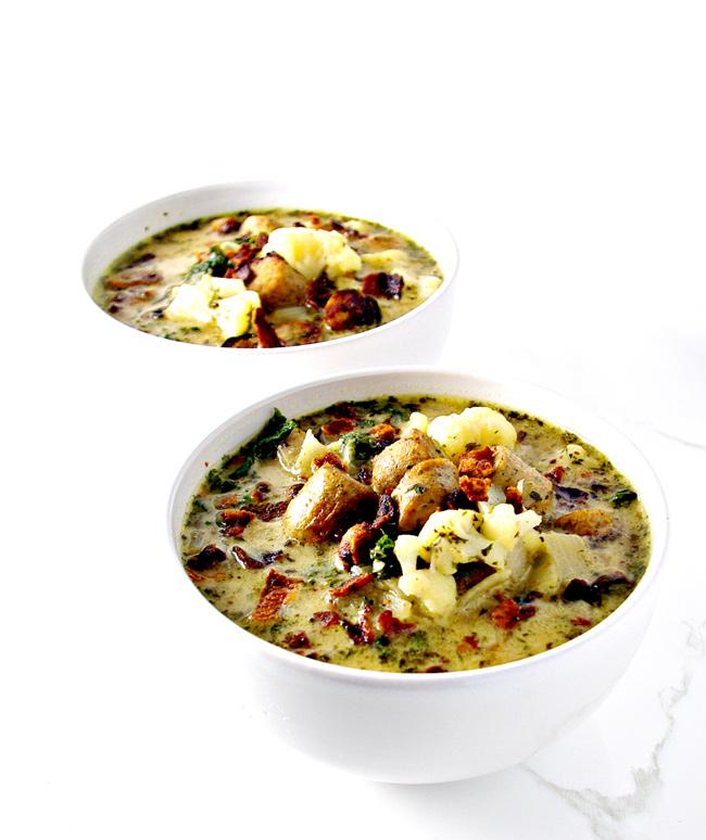 This Paleo Zuppa Toscana uses cauliflower and kale! | spiritedandthensome.com