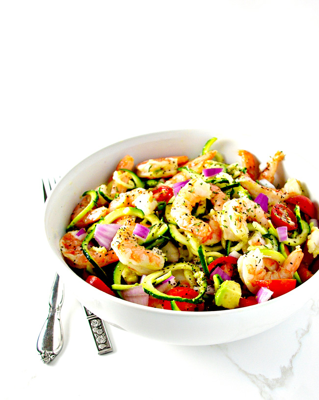 Paleo Shrimp Avocado Salad is a delicious grain-free salad recipe everyone can enjoy! It's full of garlic, cumin, and lime, to name a few ingredients! | spiritedandthensome.com