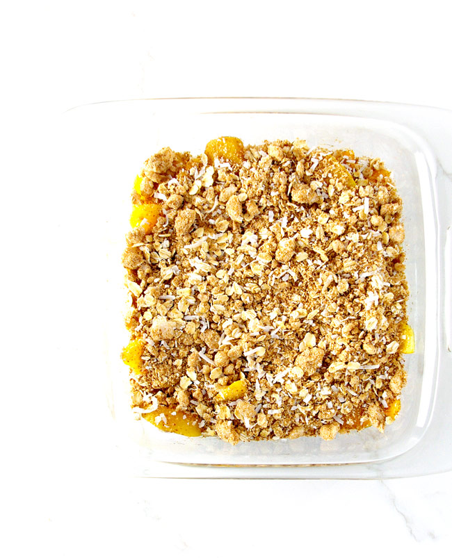 Gluten-Free Peach Crisp in a glass baking dish. | spiritedandthensome.com