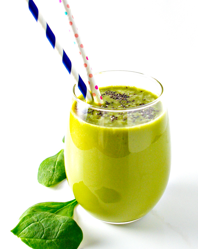 Matcha, spinach leaves, and green smoothie in a glass with a straw. | spiritedandthensome.com