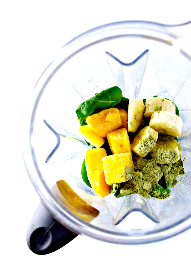 Frozen mango, banana, spinach, matcha, and almond milk in a Vitamix. | spiritedandthensome.com