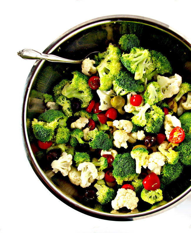 Broccoli Cauliflower Greek Salad ingredients in a stainless steel bowl. | spiritedandthensome.com