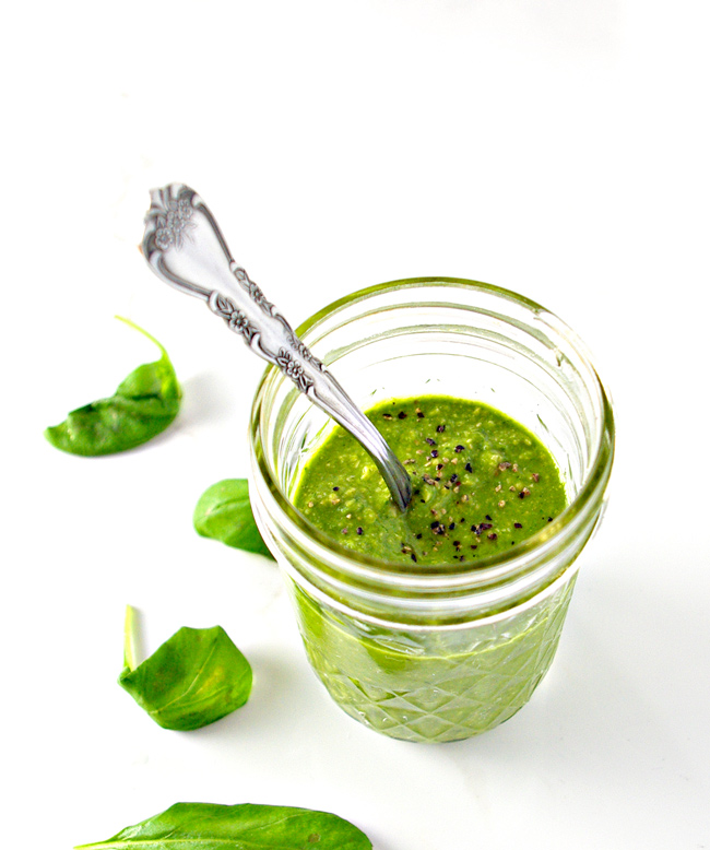 Homemade Basil Pesto is perfect for veggies, pastas, and sandwiches, to name a few! Paleo and vegan! | spiritedandthensome.com