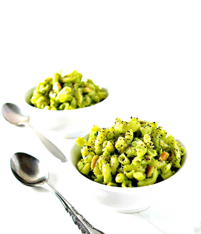 Basil pesto with pasta in white dishes. | spiritedandthensome.com