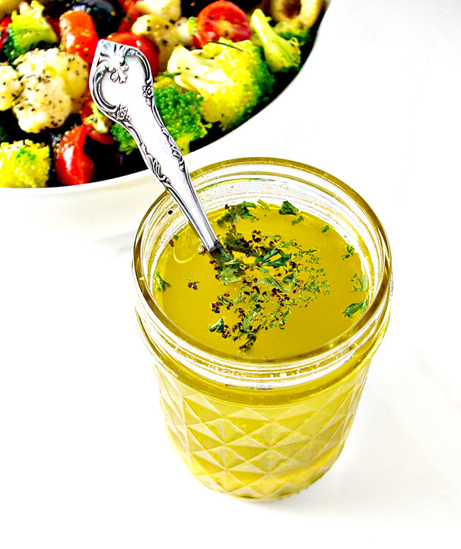 Caesar Vinaigrette with pepper and parsley in a clear jar. | spiritedandthensome.com