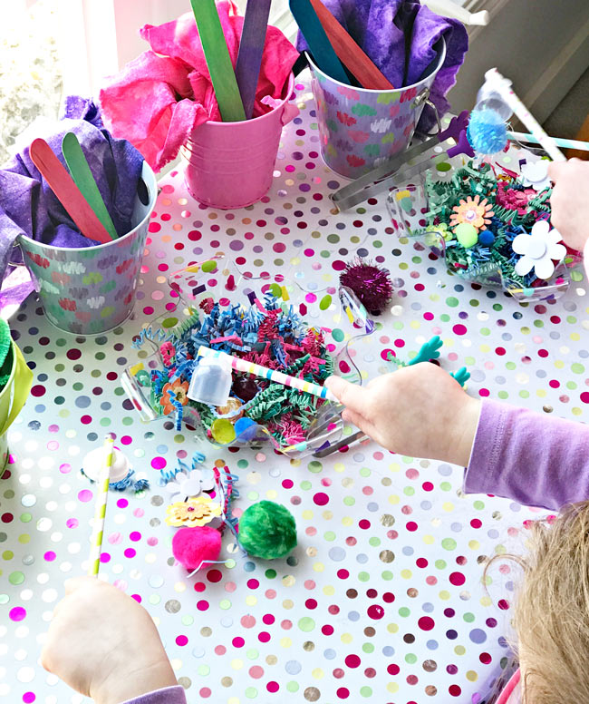 Children playing with homemade sensory toys. | spiritedandthensome.com