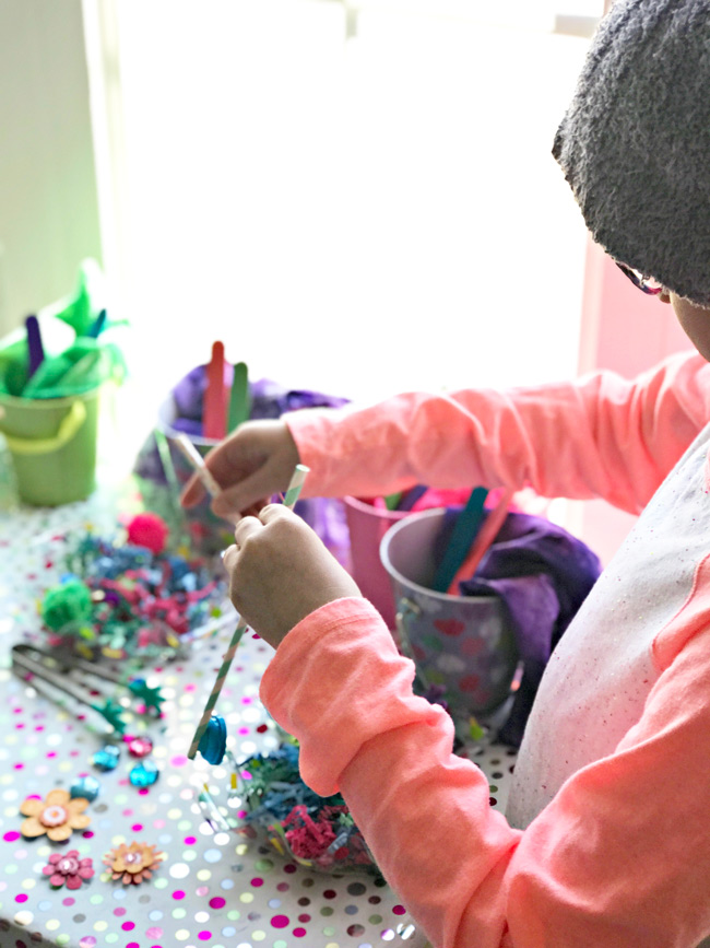 Elementary student playing with homemade sensory toys for hand-eye coordination! | spiritedandthensome.com