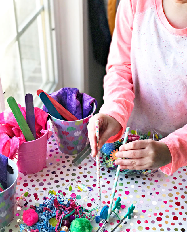 Elementary student playing with sensory activities. | spiritedandthensome.com