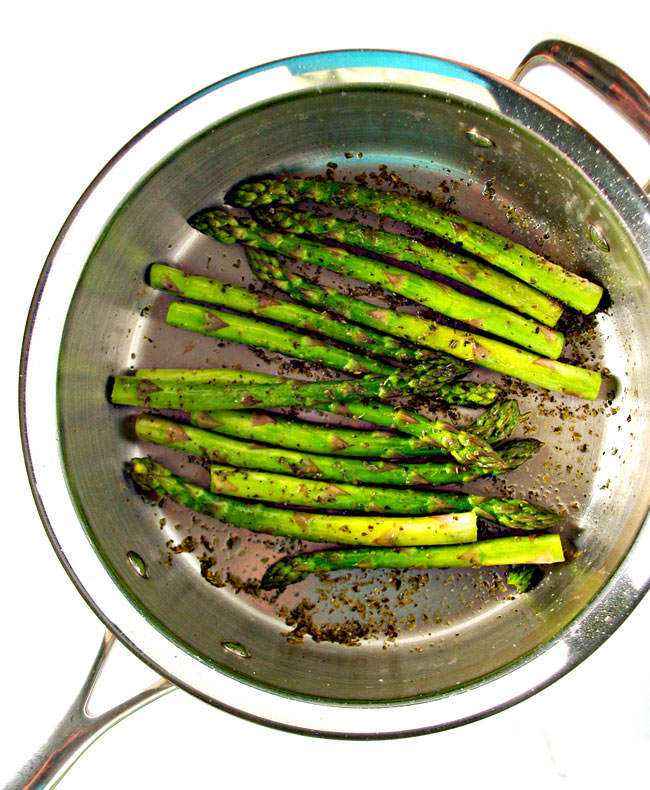 Sautéed asparagus with a bright green color near the flowering end.