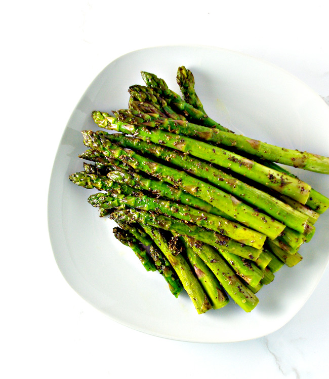 Sautéed asparagus seasoned with oregano and sea salt for a delicious soy-free, vegan side dish recipe! | spiritedandthensome.com