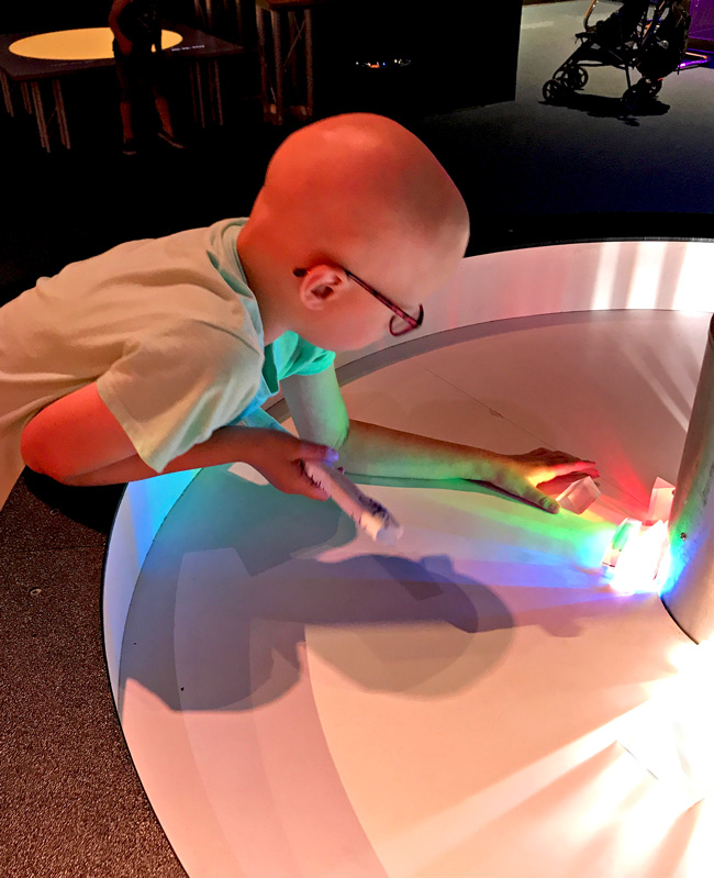 Toodle doing a hands-on experiment at the Science Center of Iowa! | spiritedandthensome.com