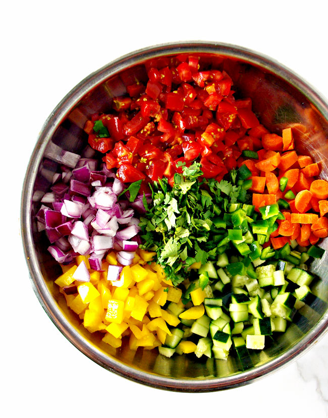 Cucumber Pico de Gallo ingredients in a stainless steel bowl, just waiting to be made! | spiritedandthensome.com