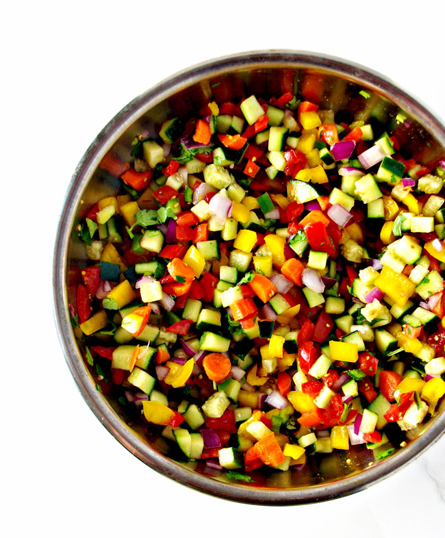 Cucumber Pico de Gallo ingredients mix together for a rainbow of delicious flavors! | spiritedandthensome.com