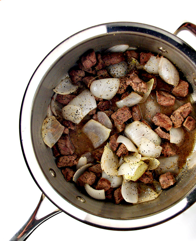 Beef stew ingredients in a sauté pan, ready for slow cooking! | spiritedandthensome.com