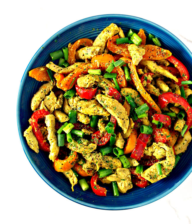 Spicy Chicken Stir-Fry is an easy paleo dinner meal! Made with bell peppers, cumin, coconut oil, and coconut cream, it's a soy-free stir-fry recipe, too! | spiritedandthensome.com