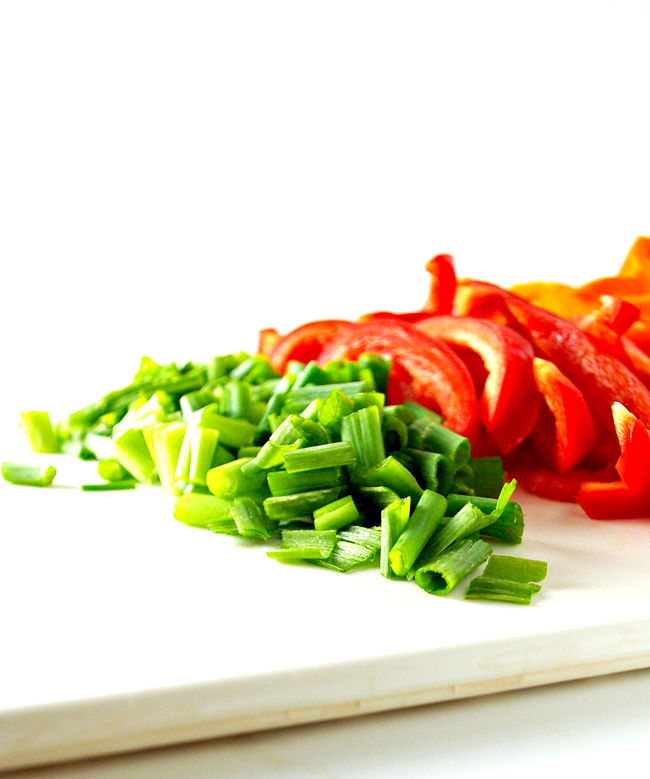 Green onions and a mix of bell peppers add robust flavor to this paleo chicken stir-fry recipe!   spiritedandthensome.com