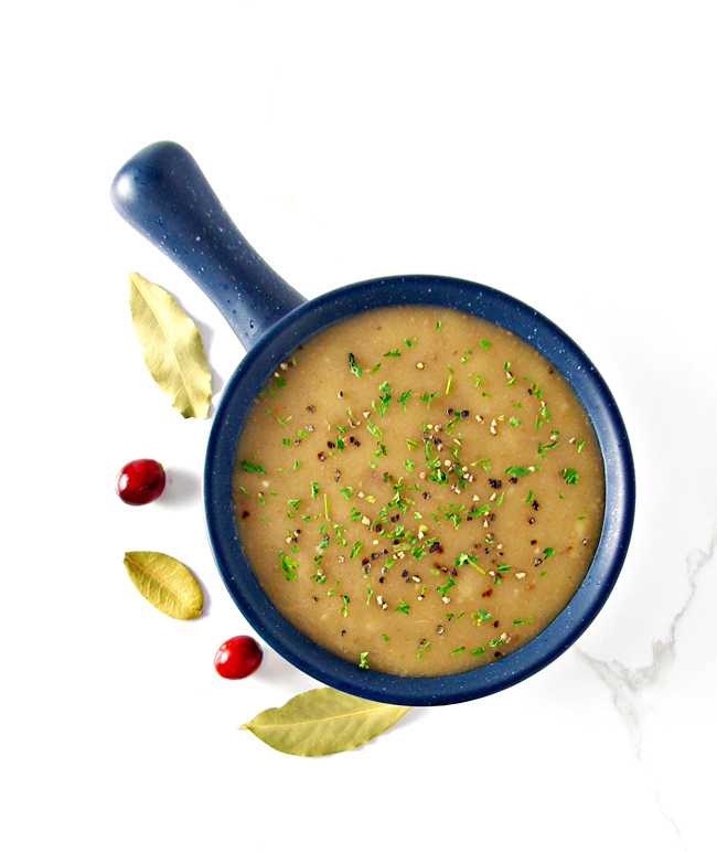 This Gluten-Free Gravy recipe is made with gluten-free flour and a gluten-free, soy-free, and dairy-free buttery spread! | spiritedandthensome.com