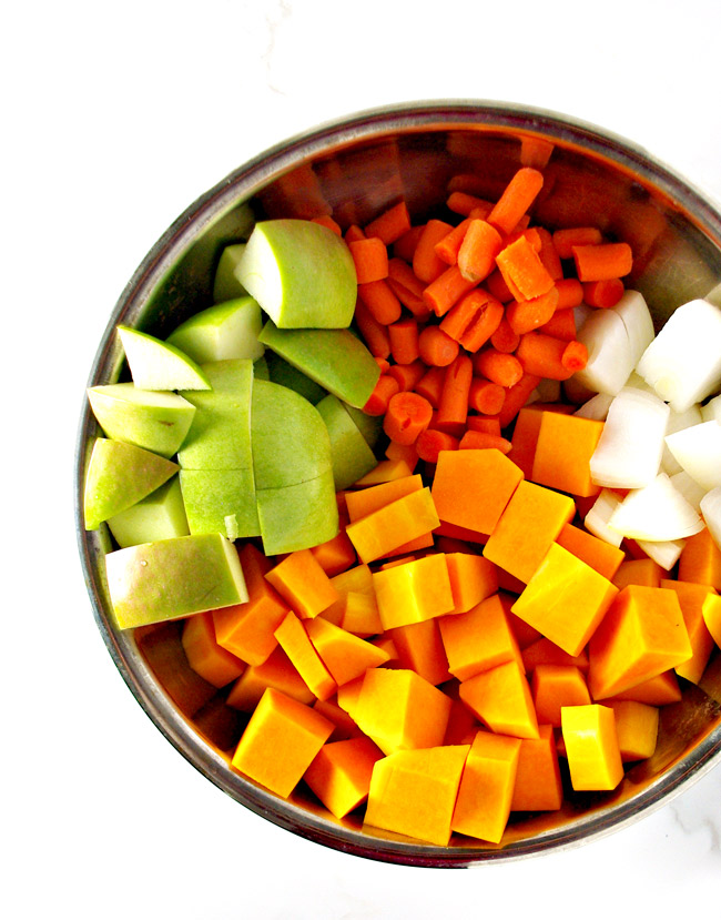 Fresh fruit and veggies ready to be roasted for Roasted Butternut Squash Soup! A delicious gluten-free and paleo soup recipe! | spiritedandthensome.com