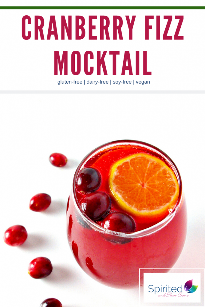 This Cranberry Fizz Mocktail is a tantalizing non-alcoholic Christmas punch recipe! Because it's made with ginger ale or sparkling water, it is also a gluten-free and vegan-friendly holiday recipe! | spiritedandthensome.com