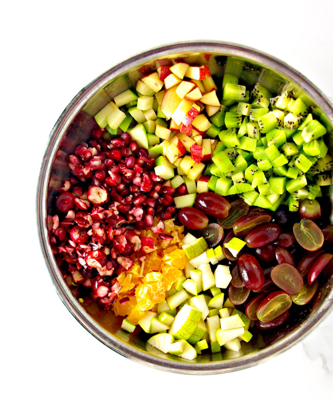 Winter Fruit Salsa ingredients include apples, pomegranates, cranberries, grapes, oranges, and kiwis! | spiritedandthensome.com