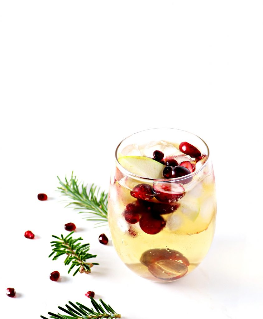 This sparkling pomegranate mimosa is made with cranberries, grapes, and apples, too, for a naturally sweet cocktail! | spiritedandthensome.com