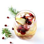Cranberry Pomegranate Mimosas are rounded out with apple slices, grapes, and champagne or sparkling wine! Your call and oh, so good! | spiritedandthensome.com