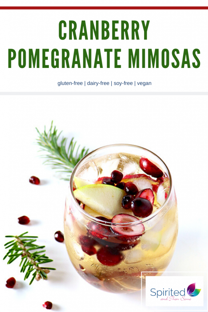 Cranberry Pomegranate Mimosas are rounded out with apple slices, grapes, and champagne or sparkling wine! Your call and oh, so good! Make it sweet or dry, you and your guests will love it! | spiritedandthensome.com