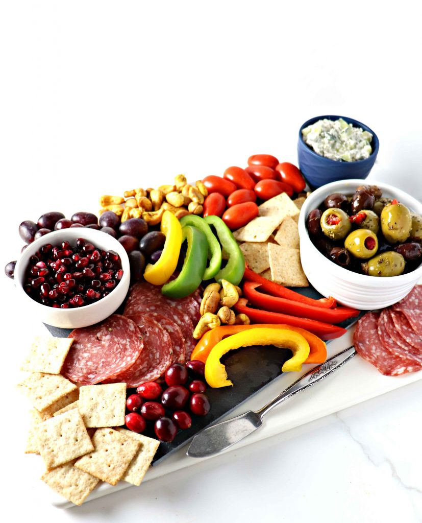 This dairy-free Healthy Charcuterie Board is full of piquant flavors that tease the tastebuds! Perfect for parties or date night in! | spiritedandthensome.com