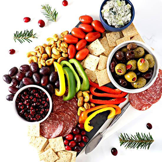 This paleo-friendly Healthy Charcuterie Board is full of piquant flavors that tease the tastebuds! Perfect for parties or date night in! {Dairy-free and gluten-free} | spiritedandthensome.com