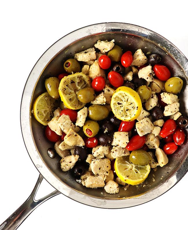 Sautéed chicken, olives, lemon, tomatoes, and capers! | spiritedandthensome.com