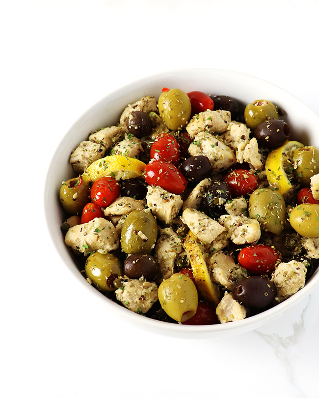 Mediterranean Chicken Sauté is an easy, one-skillet paleo dinner recipe, flavored with olives, capers, lemon, and tomatoes! | spiritedandthensome.com