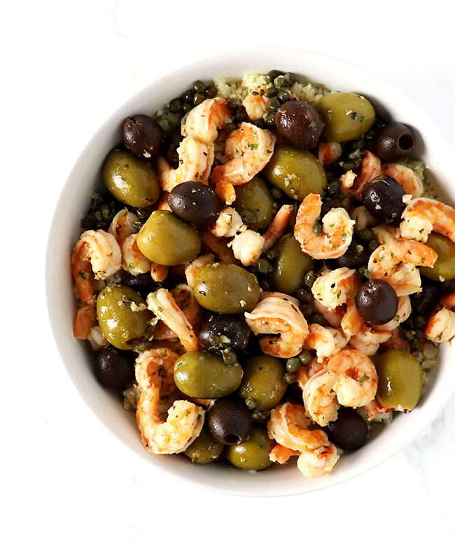 Paleo Mediterranean Shrimp Sauté is a grain-free dinner recipe with capers, olives, lemons, and garlic! | spiritedandthensome.com