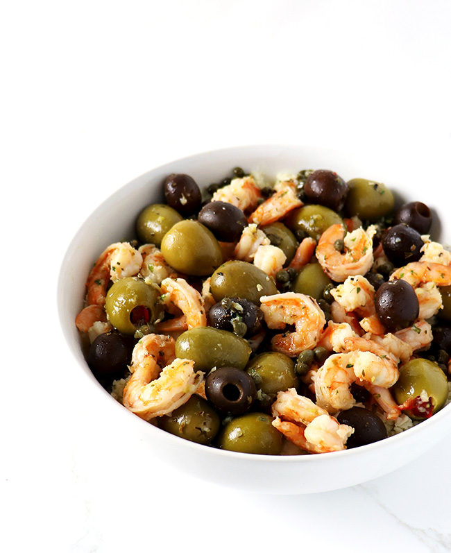 Mediterranean Shrimp Sauté is a delicious gluten-free dinner recipe! Made with capers, olives, garlic, and lemon, it boasts a piquant flavor! | spiritedandthensome.com