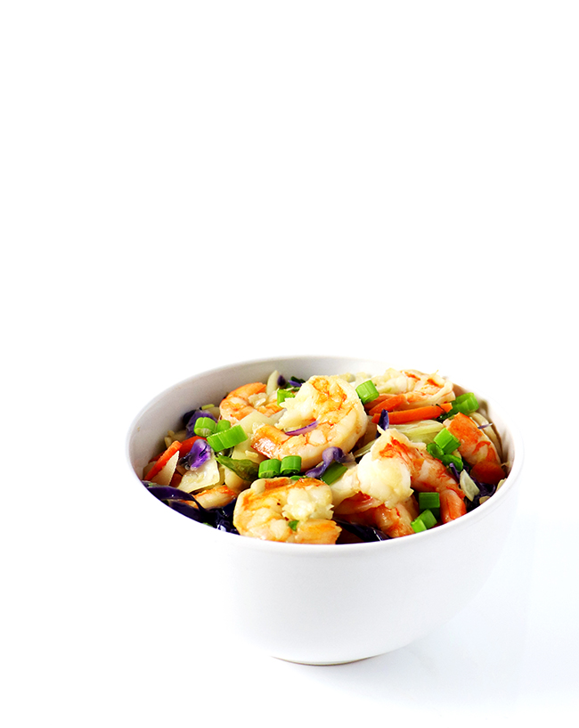 This Paleo Egg Roll Bowl is made with shrimp, cabbage, carrots, coconut aminos, garlic, and ginger for a tantalizing soy-free stir-fry recipe! | spiritedandthensome.com