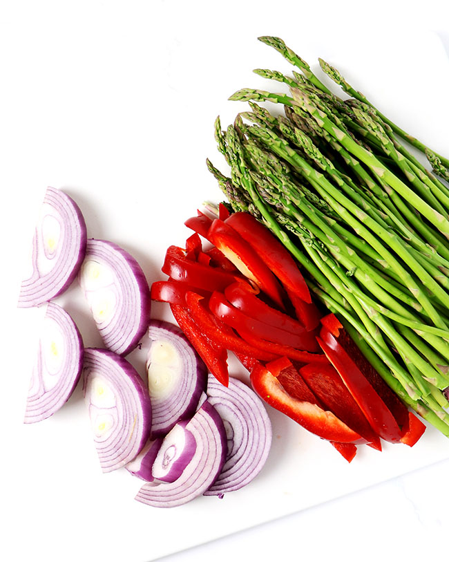 Asparagus, red bell peppers, and red onions add a lot of flavor to soy-free Asian Cashew Asparagus! | spiritedandthensome.com
