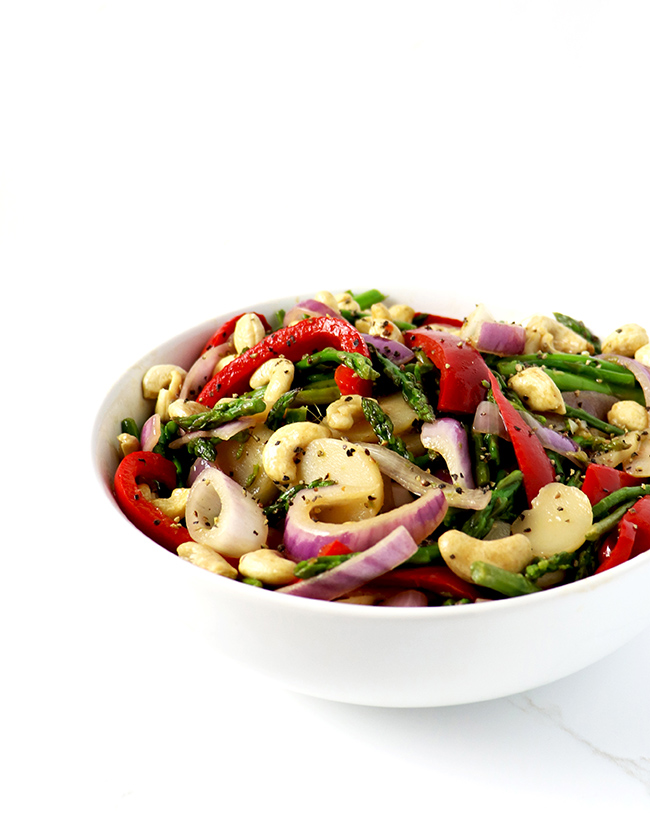 Asian Cashew Asparagus is flavored with water chestnuts, red bell peppers, red onion, and fresh garlic! | spiritedandthensome.com