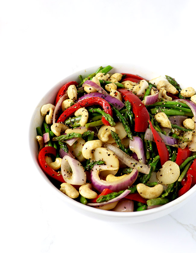 Paleo Asian Cashew Asparagus is a flavorful blend of asparagus, red onion, garlic, and red bell pepper, stirred with coconut aminos! | spiritedandthensome.com
