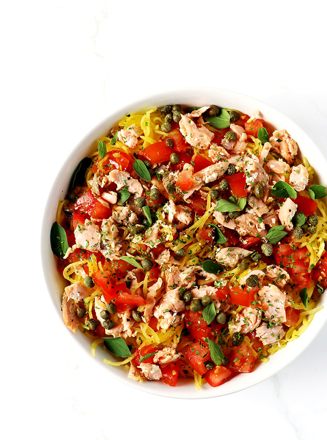 Easy Paleo Pan-Seared Salmon Pasta is made with spaghetti squash, capers, tomatoes, and oregano!   spiritedandthensome.com