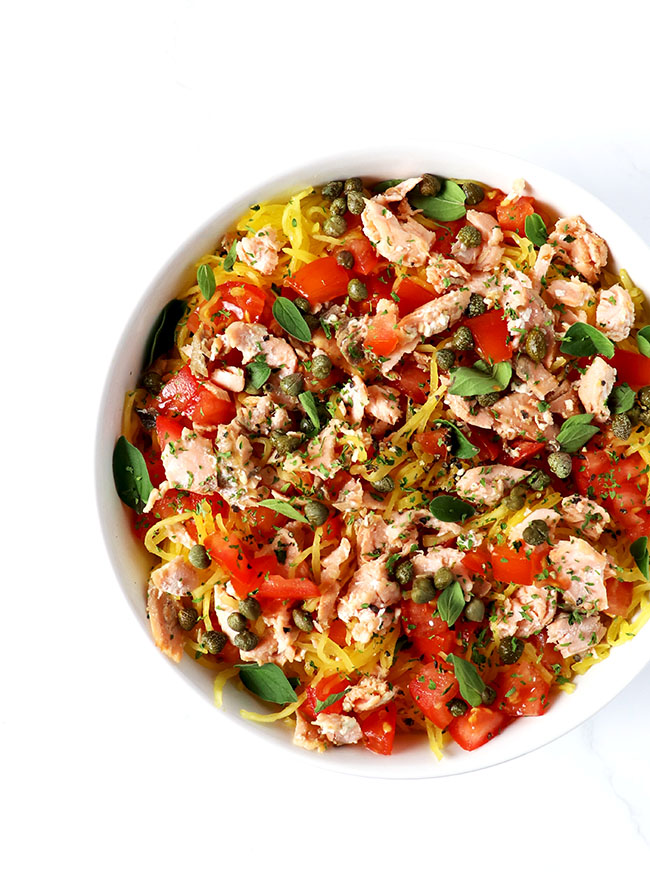 This Paleo Pan-Seared Salmon Pasta is made with capers, tomatoes, oregano, and spaghetti squash for a delicious gluten-free dinner recipe!   spiritedandthensome.com