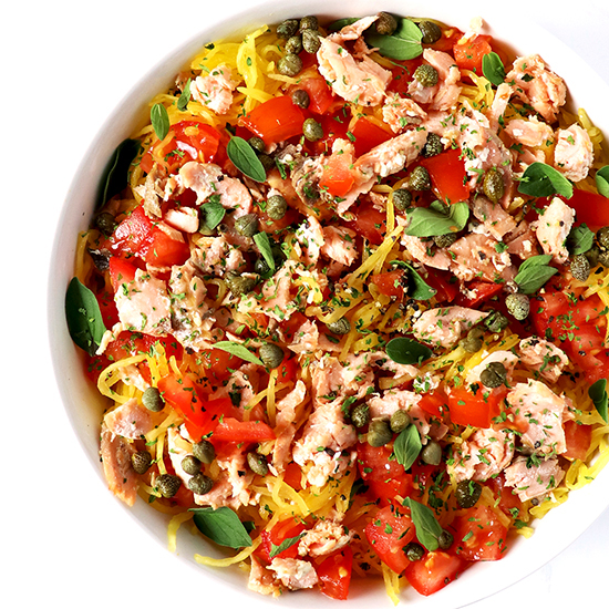 This quick and easy Paleo Pan-Seared Salmon Pasta is made with capers, salmon, and spaghetti squash for a decadent meal perfect for date night IN!   spiritedandthensome.com