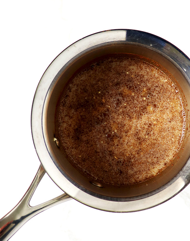 Cinnamon Quinoa Breakfast Bowl simmering in a saucepan for a sweet, vegan and gluten-free breakfast recipe! | spiritedandthensome.com