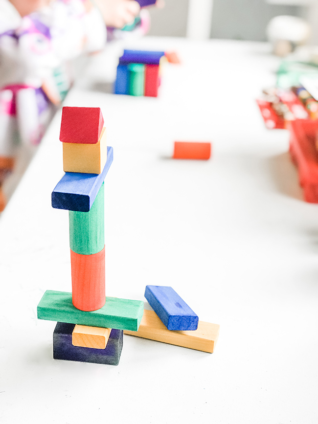 Stack of homemade Grimm's-style rainbow blocks on a table