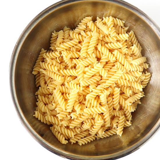 Gluten-free pasta in a stainless steel bowl