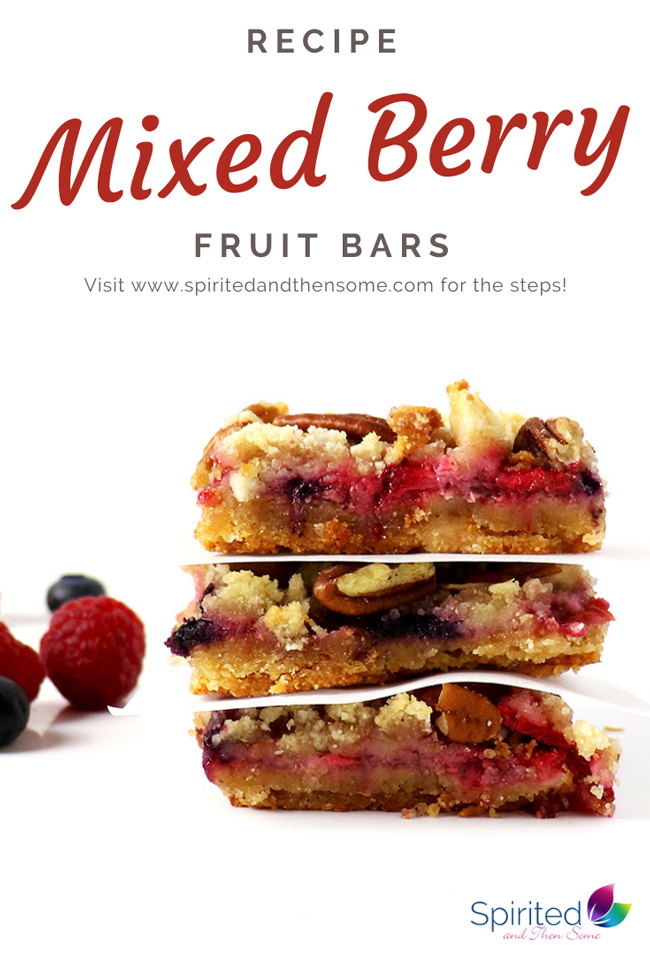 Mixed Berry Fruit Bars stacked on a marble slab, surrounded by fresh fruit