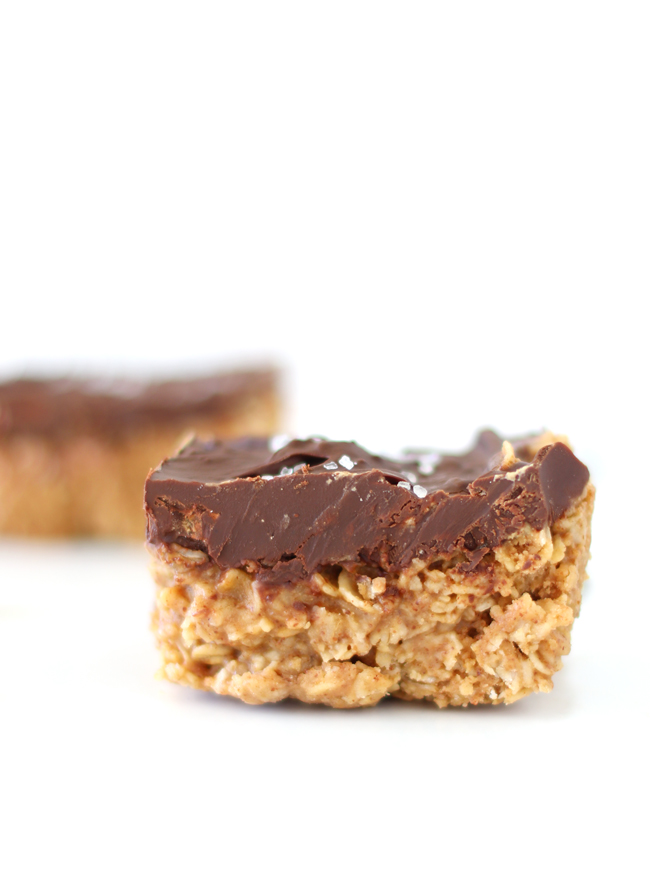 A close-up picture of Chocolate Almond Butter Oatmeal Bars on a white marble slab.