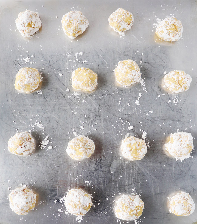 Raw Gluten-Free Lemon Sugar Cookies on a metal air-bake cooike sheet.