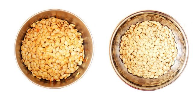 Side by side comparison of pumpkin seeds in stainless steel bowls with pulp and with pulp removed.